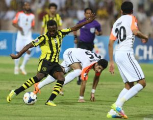 Al-Ittihad's Fahad al Muwallad (L) kicks the ball between Al-Shabab's Majed al Marshadi (C) and Bader Mansoor (R) during the AFC Champions League football match between Al-Ittihad and Al-Shabab in Mecca, on May 6, 2014. Al-Ittihad won the match 1-0. AFP PHOTO/STRINGER (Photo credit should read STRINGER/AFP/Getty Images)